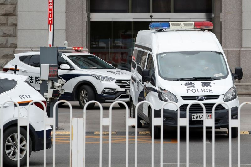 An escorted police van believed to be carrying Huayuan Real Estate Group former chairman Ren Zhiqiang leaves Beijing No. 2 Intermediate People's Court, where Ren faces corruption trial, in Beijing, China September 11, 2020. (REUTERS File Photo)