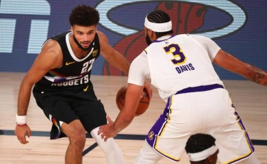 Sep 22, 2020; Lake Buena Vista, Florida, USA; Denver Nuggets guard Jamal Murray (27) dribbles the ball against Los Angeles Lakers forward Anthony Davis (3) during the second half of game three of the Western Conference Finals of the 2020 NBA Playoffs at AdventHealth Arena. (Credit: USA TODAY Sports via Reuters)