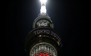 """The message reading """"Tokyo 2020 +1"""" is displayed while the Tokyo Skytree lights up in Paralympic symbol colours on the day marking the one-year countdown to the games that have been postponed to 2021 due to the coronavirus disease (COVID-19) outbreak, in Tokyo, Japan August 24, 2020. REUTERS/Issei Kato/Files"""
