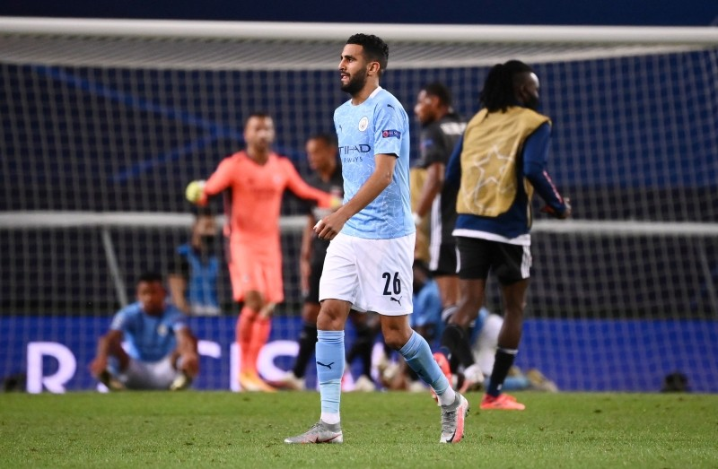Soccer Football - Champions League Quarter Final - Manchester City v Olympique Lyonnais - Jose Alvalade Stadium, Lisbon, Portugal - August 15, 2020 Manchester City's Riyad Mahrez looks dejected after the match, as play resumes behind closed doors following the outbreak of the coronavirus disease (COVID-19) Franck Fife/Pool via REUTERS/Files