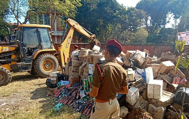 Confiscated contrabands including assortment of liquors and codeine-based cough syrups bottles are seen in this file photo taken during the disposal of such seized items by the Directorate of Excise, Nagaland, in November 2019. (Morung File Photo)