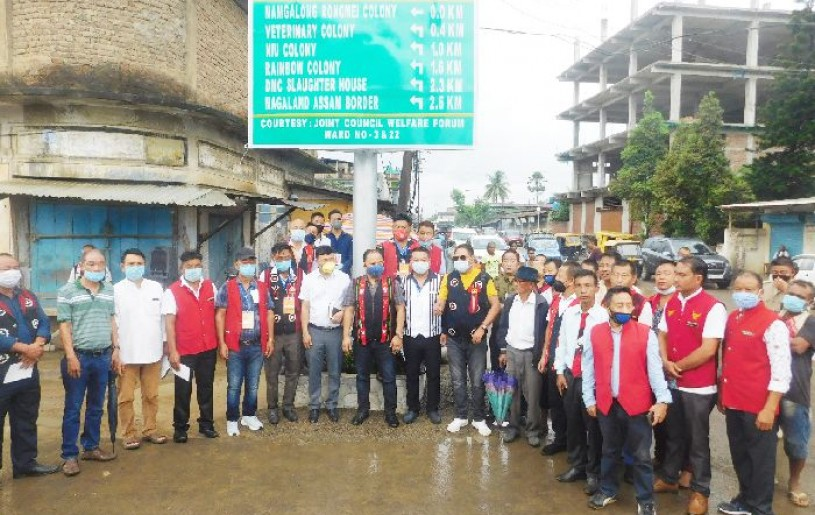 Officials and others during the installation of reflective signboard at Burma Camp junction, Dimapur under the initiative of Joint Council Welfare Forum, Ward No. 3 & 22.