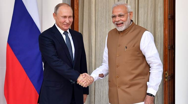 Indian Prime Minister Narendra Modi welcomes Russian President Vladimir Putin prior to their meeting at Hyderabad House in New Delhi, India October 5, 2018. Yuri Kadobnov/Pool via REUTERS