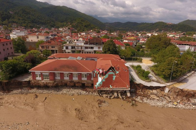 A view of a partially collapsed medical center next to the flooded Pamisos river, following a storm in the town of Mouzaki, in central Greece on September 19, 2020. Picture taken with a drone. (REUTERS Photo)