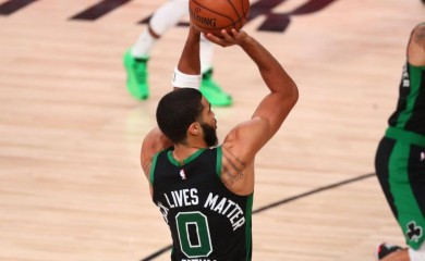 Boston Celtics forward Jayson Tatum (0) shoots against the Miami Heat during the second half in game five of the Eastern Conference Finals of the 2020 NBA Playoffs at AdventHealth Arena. (USA TODAY Sports Photo via Reuters)