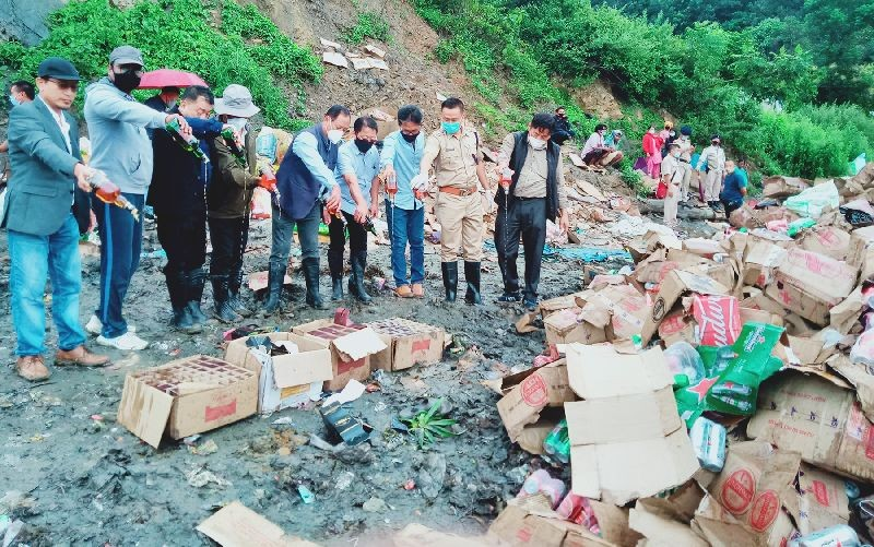 Advisor Zhaleo Rio and others during the destruction of seized liquor on September 25 in Kohima. (Morung Photo)