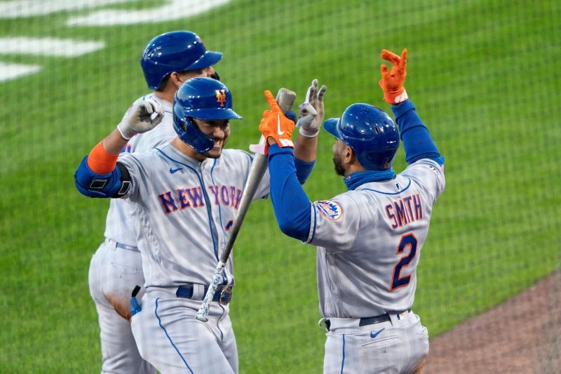 FILE PHOTO: New York Mets first baseman Dominic Smith (2) congratulates Mets right fielder Michael Conforto (30) for hitting a three run home run during the third inning against the Toronto Blue Jays at Sahlen Field. Sep 11, 2020; Buffalo, New York, USA; Gregory Fisher-USA TODAY Sports/File Photo