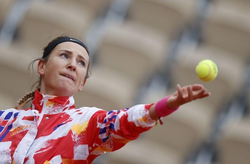 Belarus' Victoria Azarenka in action during her first round match against Montenegro's Danka Kovinic. REUTERS/Christian Hartmann