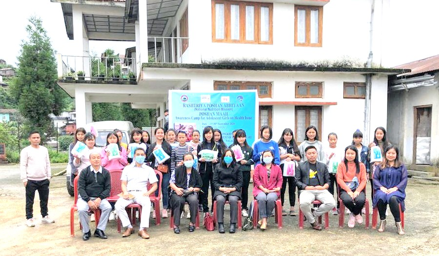 Officials and participants during the awareness camp for adolescent girls on health issue held at DUDU Hall, Longkhim on September 24.
