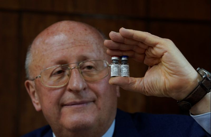 Alexander Gintsburg, director of the Gamaleya National Research Center for Epidemiology and Microbiology, shows bottles with Sputnik-V vaccine against the coronavirus disease (COVID-19) during an interview with Reuters in Moscow, Russia on September 24, 2020. (REUTERS Photo)