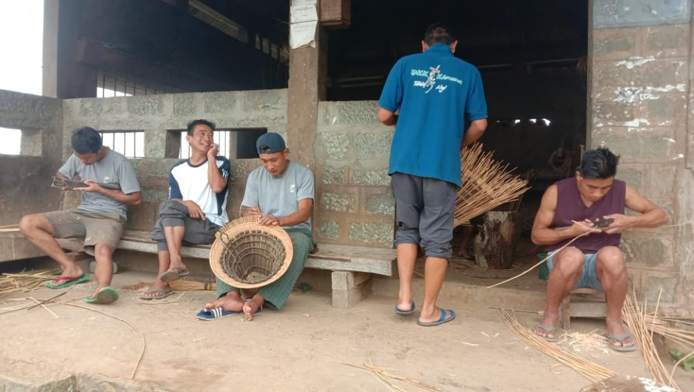 Young men learning to weave baskets at one of the Thehou in Khonoma village. (Morung Photo)