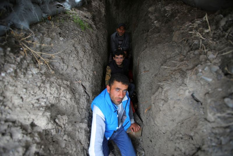 Local residents take shelter in a dugout during the fighting over the breakaway region of Nagorno-Karabakh in the city of Terter, Azerbaijan on September 30, 2020. (REUTERS Photo)