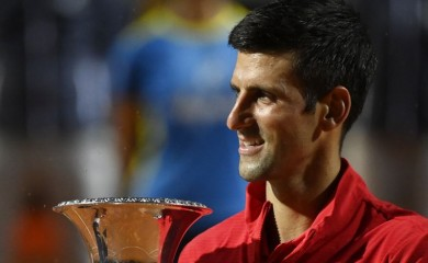 Novak Djokovic celebrates with the trophy after winning the final against Argentina's Diego Schwartzman Pool via REUTERS/Riccardo Antimiani