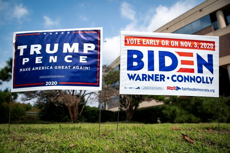 Yard signs supporting U.S. President Donald Trump and Democratic U.S. presidential nominee and former Vice President Joe Biden are seen outside of an early voting site at the Fairfax County Government Center in Fairfax, Virginia, US on September 18, 2020. (REUTERS File Photo)