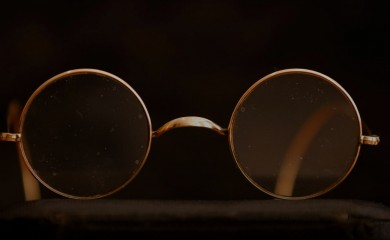 "A pair of round Windsor spectacles that belonged to John Lennon is seen at Sotheby's auction house ahead of their ""Beatles for Sale"" auction in London, Britain September 25, 2020. REUTERS/John Sibley"