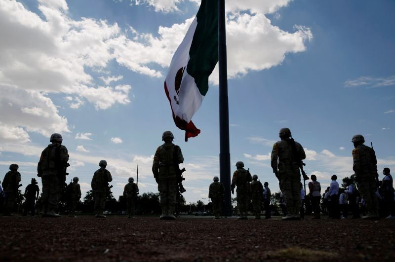 Members of Mexico's National Guard stand in formation as they hold a minute of silence as part of a 30-day national mourning for the deaths and infections caused by the coronavirus disease (COVID-19), in Ciudad Juarez, Mexico on September 1, 2020. (REUTERS Photo)
