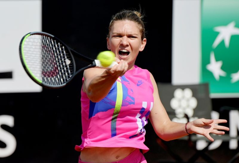 Romania's Simona Halep in action during her second round match against Italy's Jasmine Paolini on September 16. Pool via REUTERS/Riccardo Antimiani