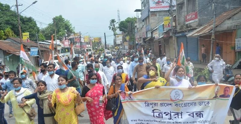 Protestors carrying a banner during the 12 hour shutdown called by the Congress in Tripura on September 21. (IANS Photo)