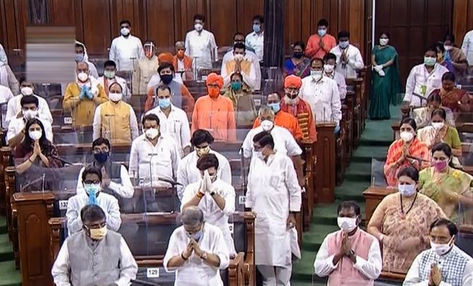 MPs pay tribute to ex-President Pranab Mukherjee, legendary Indian classical vocalist Pandit Jasraj and others who passed away this year, during the opening day of Parliament's monsoon session amid the ongoing coronavirus pandemic at Parliament House in New Delhi.