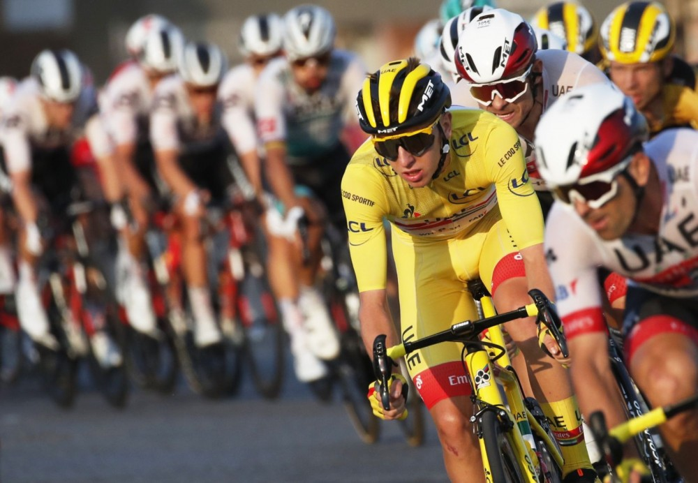 Cycling - Tour de France - Stage 21 - Mantes-la-Jolie to Paris Champs-Elysees - France - September 20, 2020. UAE Team Emirates rider Tadej Pogacar of Slovenia, wearing the overall leader's yellow jersey, in action in the peloton. REUTERS/Stephane Mahe