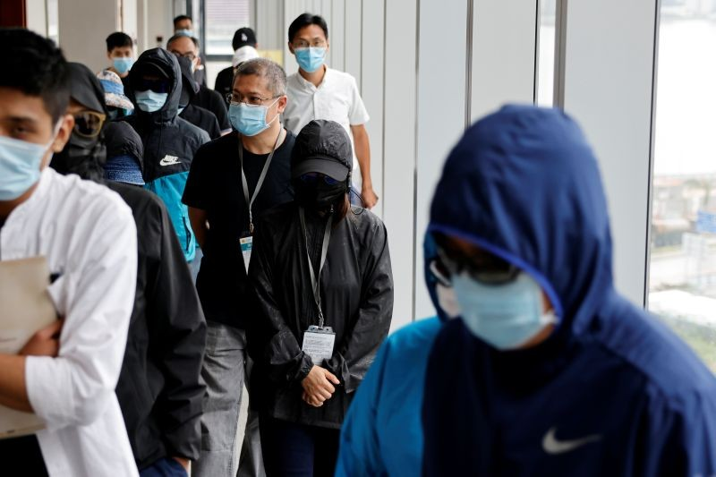 Mrs Wong (C), wife of Wong Wai Yin, one of the twelve Hong Kong detained activists, apprehended as they reportedly sailed to Taiwan for political asylum, arrives to attend a news conference in Hong Kong, China September 12, 2020. (REUTERS File Photo)