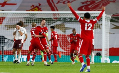 Liverpool's Diogo Jota celebrates scoring their third goal with teammates Pool via REUTERS/Jason Cairnduff