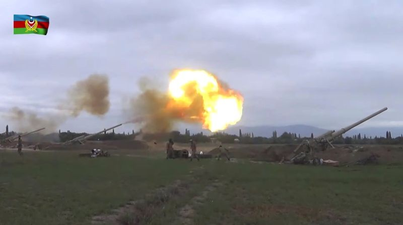A still image from a video released by the Azerbaijan's Defence Ministry shows members of Azeri armed forces firing artillery during clashes between Armenia and Azerbaijan over the territory of Nagorno-Karabakh in an unidentified location, in this still image from footage released September 28, 2020. (REUTERS Photo)