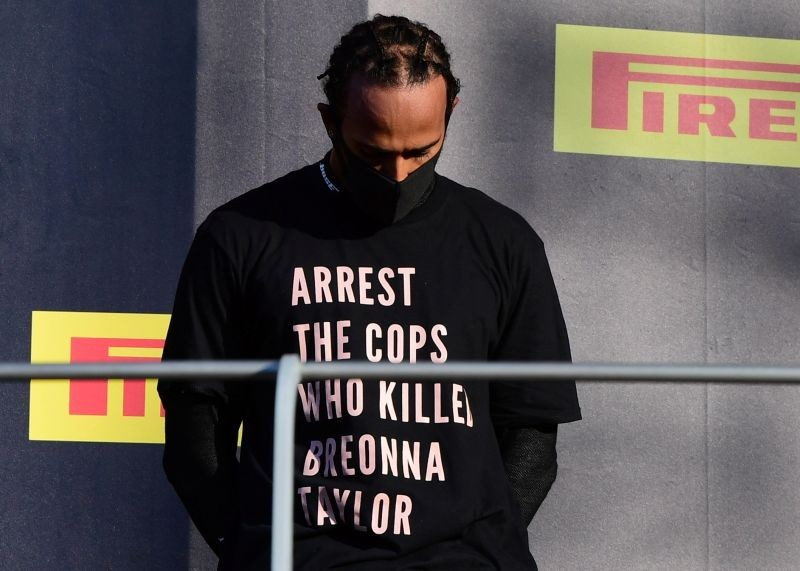 Mercedes' Lewis Hamilton wears a shirt in reference to Breonna Taylor on the podium as he celebrates after winning the race Pool via REUTERS/Jennifer Lorenzini