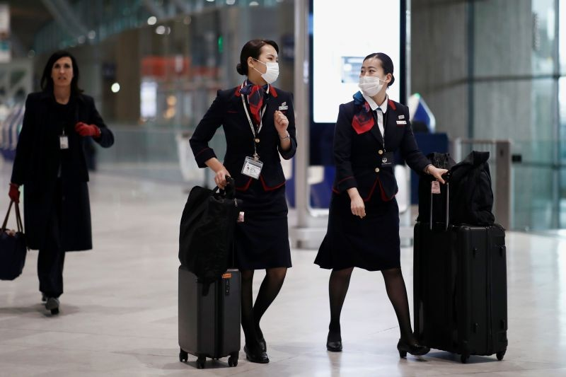 Japan Airlines flight attendants wearing face masks are seen at Paris Charles de Gaulle airport, following the coronavirus disease (COVID-19) outbreak, in Roissy-en-France, France on March 16, 2020. (REUTERS File Photo)