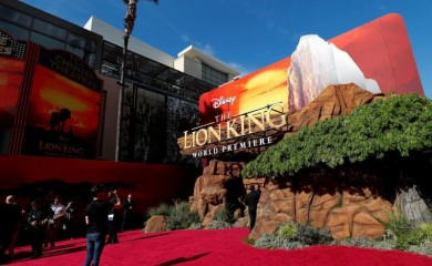 """FILE PHOTO: A person takes pictures ahead of the World Premiere of """"The Lion King"""" in Los Angeles, California, US, July 9, 2019. (Reuters File Photo)"""