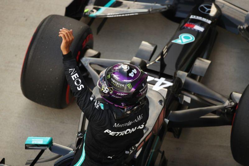 Lewis Hamilton celebrates qualifying in pole position. Pool via REUTERS/Bryn Lennon