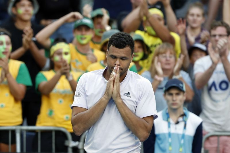 FILE PHOTO: France's Jo-Wilfried Tsonga looks dejected after retiring from his match against Australia's Alexei Popyrin. REUTERS/Issei Kato