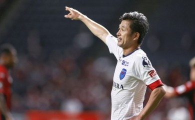Yokohama FC's Japanese striker Kazuyoshi Miura who is recognised as the world's oldest goalscorer and oldest player currently playing in a professional league, gestures during J. League YBC Levain Cup soccer match against Hokkaido Consadole Sapporo in Sapporo, northern Japan August 12, 2020. (Photo credit: Kyodo/via REUTERS)