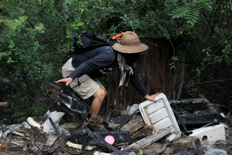 A volunteer anthropologist takes part in a search for skeletal remains and clothing at a plot of land, in the municipality of Hidalgo, on the outskirts of Monterrey, Mexico on September 3, 2020. (REUTERS Photo)