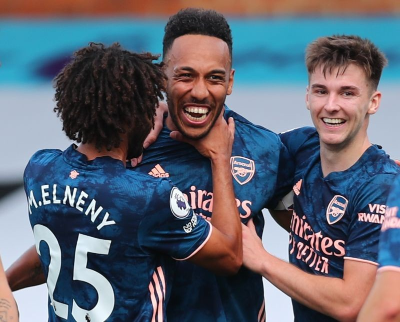 Arsenal's Pierre-Emerick Aubameyang celebrates scoring their third goal with Kieran Tierney and Mohamed Elneny Pool via REUTERS/Clive Rose