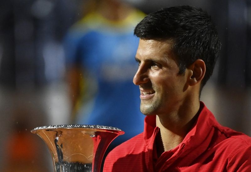 Novak Djokovic celebrates with the trophy after winning the final against Argentina's Diego Schwartzman Pool via REUTERS/Riccardo Antimiani