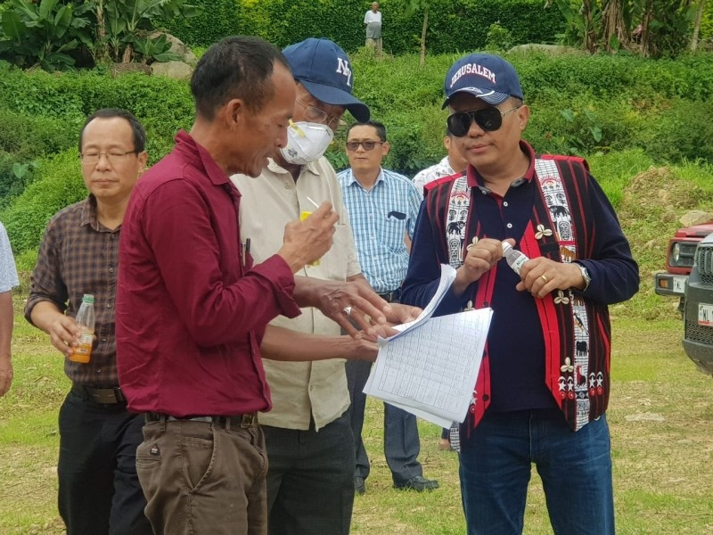 Officials and contractor briefing about the ongoing works to APC Y Kikheto Sema, IAS at Kumbani Stadium, Mangkolemba during inspection of NEC projects under Mokokchung district on September 16. (Morung Photo)