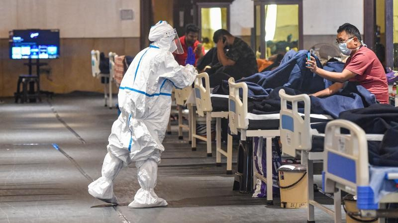 COVID-19 patients inside an isolation ward in Shehnai Banquet Hall near LNJP Hospital, in New Delhi. PTI photo