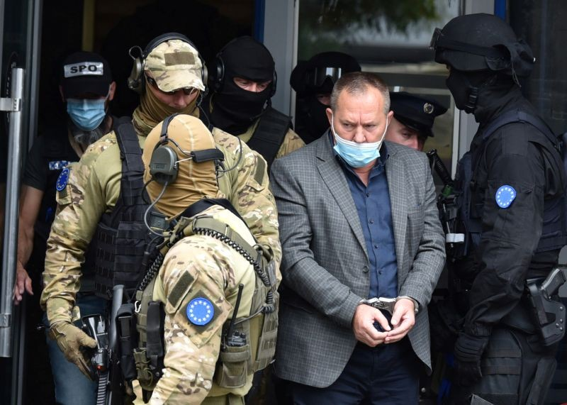 Special police units from the European Union rule-of-law mission, EULEX, arrest the leader of Kosovo Liberation Army War Veterans Organisation, Hysni Gucati, during a raid on the organisation's offices in Pristina, Kosovo on September 25. (REUTERS Photo)