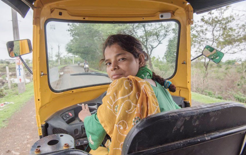 Talat Jahan, a domestic abuse survivor, sits in her tuk-tuk in Bhopal India. (Thomson Reuters Foundation Photo)