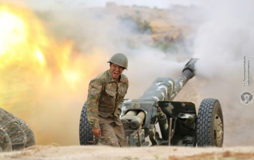 An ethnic Armenian soldier fires an artillery piece during fighting with Azerbaijan's forces in the breakaway region of Nagorno-Karabakh, in this handout picture released on September 29, 2020. (REUTERS Photo)