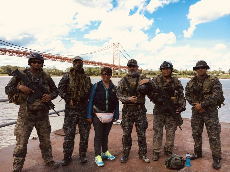 Environmental prosecutor Karina Garay (centre) and the Peruvian navy patrol the Madre de Dios River, Peru, looking for illegal mining activity, Peru on November 26, 2019. (Thomson Reuters Foundation File Photo)