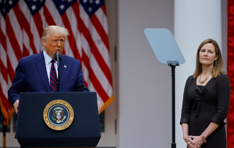U.S. Court of Appeals for the Seventh Circuit Judge Amy Coney Barrett reacts as U.S President Donald Trump holds an event to announce her as his nominee to fill the Supreme Court seat left vacant by the death of Justice Ruth Bader Ginsburg, who died on September 18, at the White House in Washington, U.S., September 26, 2020. REUTERS/Carlos Barria