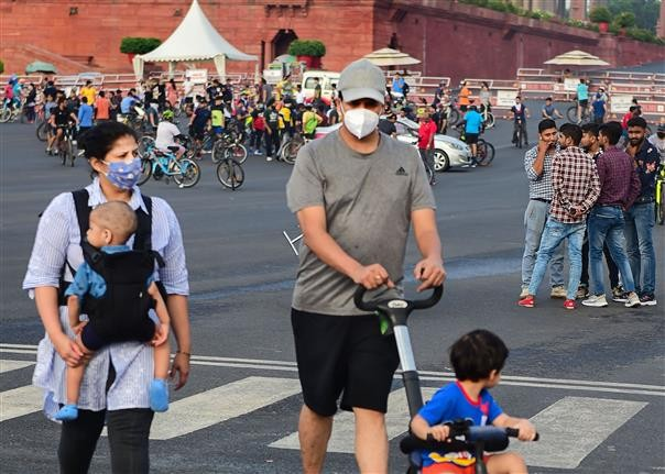 A couple with their children walks at Raisina Hills in New Delhi.PTI File Photo