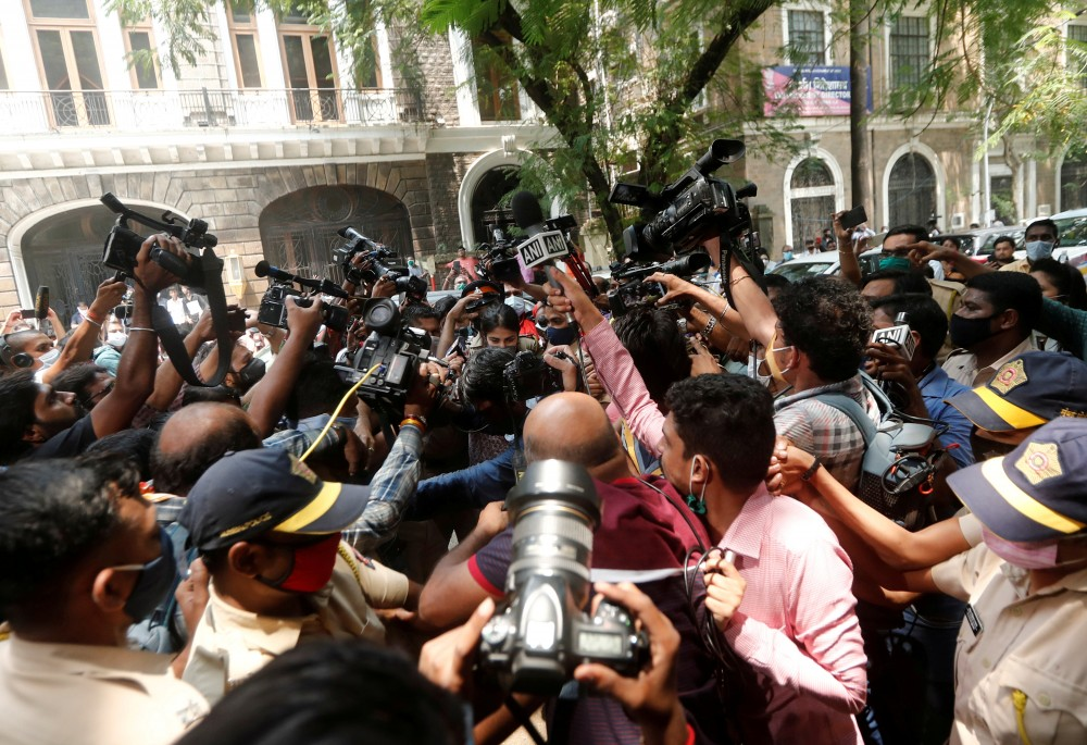 FILE PHOTO: Media personnel surround Bollywood actor Rhea Chakraborty as she arrives at Narcotics Control Bureau (NCB) office for questioning, following the death of her boyfriend and actor Sushant Singh Rajput, in Mumbai, India, September 6, 2020. Picture taken September 6, 2020. REUTERS/Francis Mascarenhas/File Photo