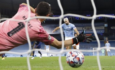 Manchester City's Sergio Aguero scores their first goal from the penalty spot Pool via REUTERS/Phil Noble