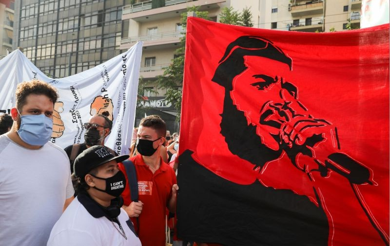 A banner depicting anti-racist Greek rapper Pavlos Fyssas is seen, as demonstrators protest ahead of a trial of leaders and members of the far-right Golden Dawn, in Athens, Greece on October 7, 2020. (REUTERS Photo)