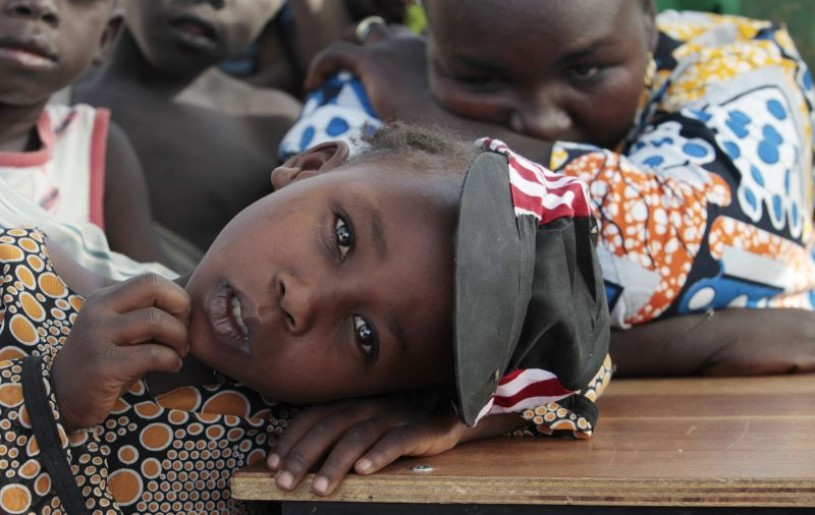 A girl displaced as a result of Boko Haram attack in the northeast region of Nigeria, rests her head on a desk at Maikohi secondary school camp for internally displaced persons (IDP) in Yola, Adamawa State January 13, 2015. Boko Haram says it is building an Islamic state that will revive the glory days of northern Nigeria's medieval Muslim empires, but for those in its territory life is a litany of killings, kidnappings, hunger and economic collapse. Picture taken January 13, 2015. (REUTERS File Photo)