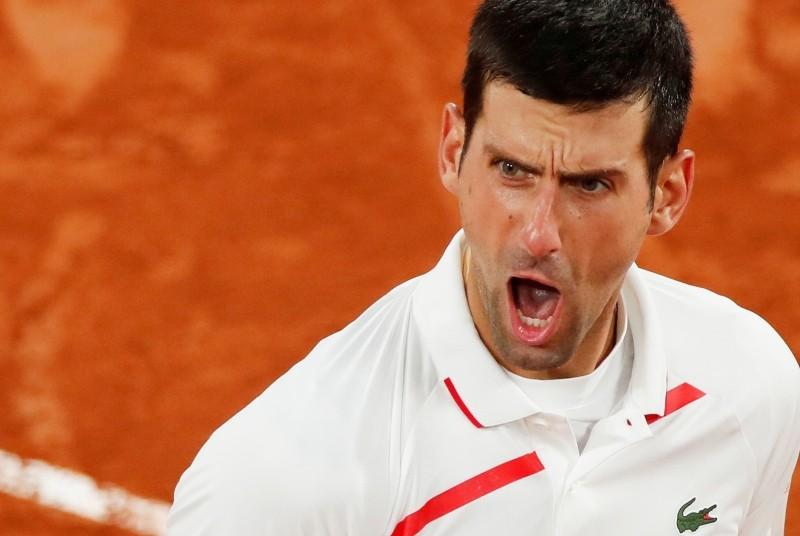 Tennis - French Open - Roland Garros, Paris, France - October 7, 2020 Serbia's Novak Djokovic reacts during his quarter final match against Spain's Pablo Carreno Busta REUTERS/Gonzalo Fuentes
