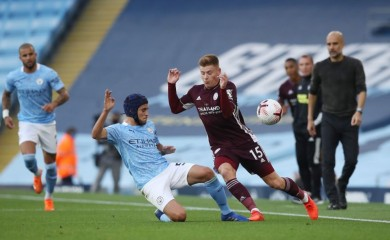 Manchester City's Eric Garcia in action with Leicester City's Harvey Barnes Pool via REUTERS/Martin Rickett/Files